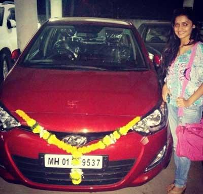 Hruta Durgule Owns Red Hyundai Car